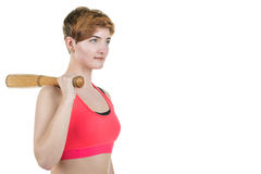 Healthy lifestyle, sport. A young girl is holding a baseball bat, on a white background. Horizontal frame Royalty Free Stock Photography