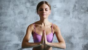 Pretty young woman doing yoga exercise at home. stock footage