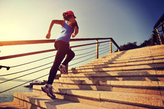 Healthy lifestyle sports woman running up on stone stairs Stock Photo
