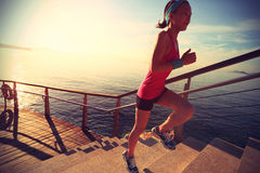 Healthy lifestyle sports woman running up on stone stairs Stock Photography