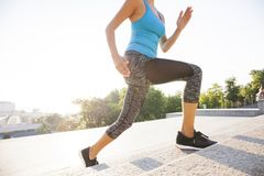 Healthy lifestyle sports woman running up on stone stairs sunrise seaside Stock Images