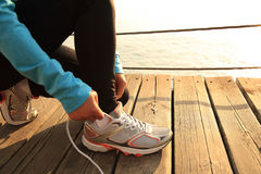Healthy lifestyle sports woman tying shoelaces Royalty Free Stock Photo