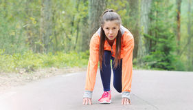 Healthy lifestyle sporty woman begining run early in the morning Royalty Free Stock Photo