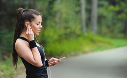 Healthy lifestyle sporty woman with headphone jogging in beautif Stock Photography