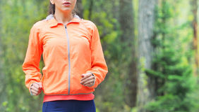 Healthy lifestyle sporty woman running early in the morning in f Royalty Free Stock Photography