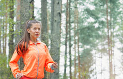 Healthy lifestyle sporty woman running early in the morning in f Stock Photo
