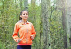 Healthy lifestyle sporty woman running early in the morning in f Stock Photography