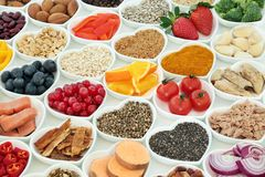 Healthy Lifestyle Super Food. Concept with fresh fruit, vegetables, fish, seeds, nuts, cereals, herbs and spices with medicinal herbs. Foods high in stock photos