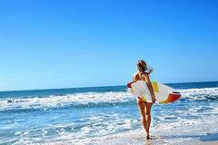 Healthy Lifestyle. Surfing. Water Sports. Woman With Surfboard. Royalty Free Stock Photos