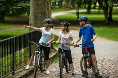 Healthy lifestyle - people riding bicycles in city park Stock Photos