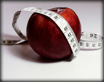 Healthy lifestyle, we watch the diet, we consider calories Royalty Free Stock Photography
