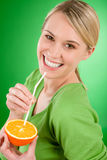 Healthy lifestyle - woman drink juice from orange Stock Photos
