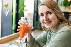 Healthy Lifestyle Woman Drinking Glass Of Fresh Carrot Juice Stock Photos