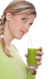 Healthy lifestyle - Woman drinking kiwi juice Stock Photos