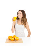 Healthy lifestyle woman drinking orange juice Stock Images