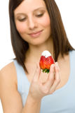 Healthy lifestyle - woman eat strawberry Royalty Free Stock Images