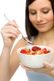 Healthy lifestyle - woman eat strawberry cereal Stock Photo