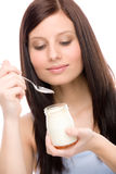 Healthy lifestyle - woman eat yogurt Royalty Free Stock Image