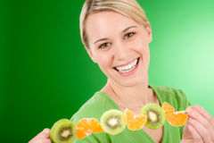 Healthy lifestyle - woman eating kiwi and orange Royalty Free Stock Photo