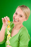 Healthy lifestyle - woman eating kiwi and orange Stock Photos