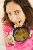 Healthy lifestyle woman eating porridge Stock Images