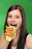 Healthy lifestyle - woman enjoy cheese sandwich Stock Images