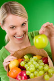 Healthy lifestyle - woman with fruit in paper bag Royalty Free Stock Images
