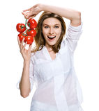 Healthy lifestyle woman holding a bunch of tomatoes in her hands, healthy food concept Stock Images