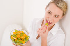 Healthy lifestyle - woman holding fruit salad Royalty Free Stock Images