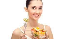 Healthy lifestyle, woman holding fruit salad Stock Photography