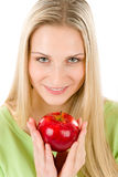 Healthy lifestyle - woman holding red apple. On white background Royalty Free Stock Photos
