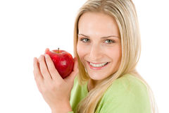 Healthy lifestyle - woman holding red apple. On white background Stock Photos