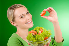 Healthy lifestyle - woman holding vegetable salad Stock Photo