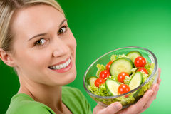 Healthy lifestyle - woman holding vegetable salad Stock Images