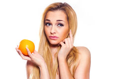 Healthy Lifestyle Woman holds orange.   She is full of emotion. Royalty Free Stock Image