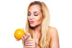 Healthy Lifestyle Woman holds orange.   She wants to kiss orange. Stock Image