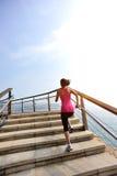 Healthy lifestyle woman legs running on stone stai Stock Photos