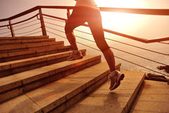 Healthy lifestyle woman legs running on stone stairs. Healthy lifestyle sports woman legs running on stone stairs seaside Stock Image