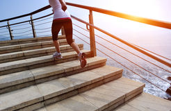 Healthy lifestyle woman legs running on stone stairs Royalty Free Stock Photography