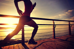 Healthy lifestyle woman runner running seaside Stock Image