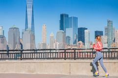 Healthy lifestyle. Woman is running in New York City Royalty Free Stock Photos