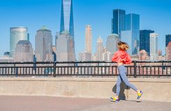 Healthy lifestyle. Woman is running in New York City Royalty Free Stock Image