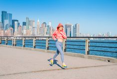 Healthy lifestyle. Woman is running in New York City Royalty Free Stock Images