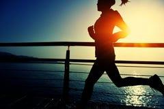 Healthy lifestyle woman running seaside Stock Photos