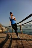 Healthy lifestyle woman running seaside Stock Image