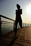 Healthy lifestyle woman running seaside Royalty Free Stock Images
