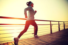 Healthy lifestyle woman running seaside Royalty Free Stock Photo
