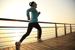 Healthy lifestyle woman running seaside Stock Photography