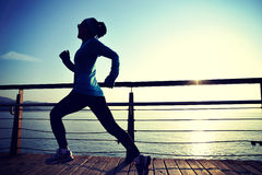 Healthy lifestyle woman running seaside Stock Image