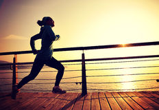 Healthy lifestyle woman running seaside Royalty Free Stock Photography